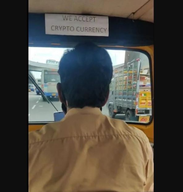 Indian Rickshaw driver accepting crypto